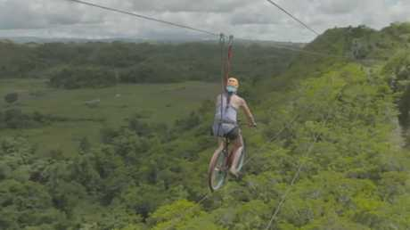 Bike ziplining at the Philippines' Chocolate Hills Adventure Park with Travel Guides. Picture: Channel 9