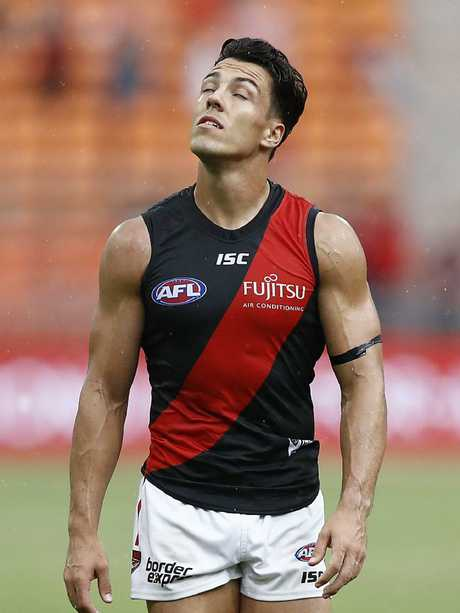 A dejected Dylan Shiel takes stock after Essendon's heavy Round 1 loss. Picture: Ryan Pierse/Getty Images.