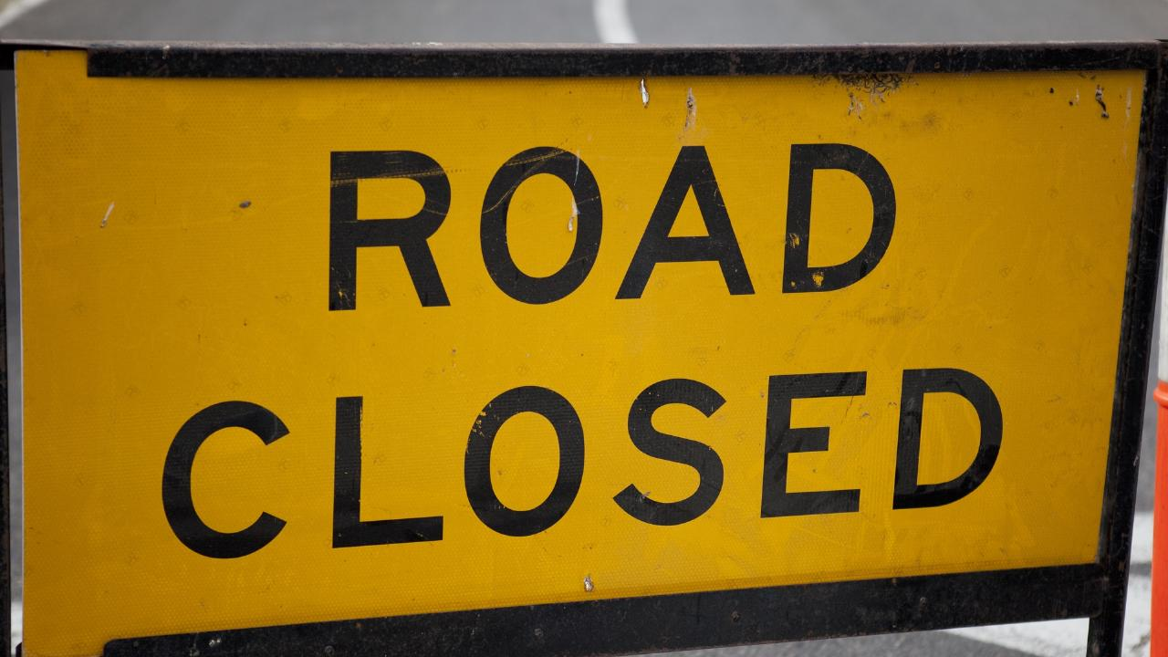 A section of the Tasman Highway on Tasmania's East Coast has been closed after a truck rolled this morning.