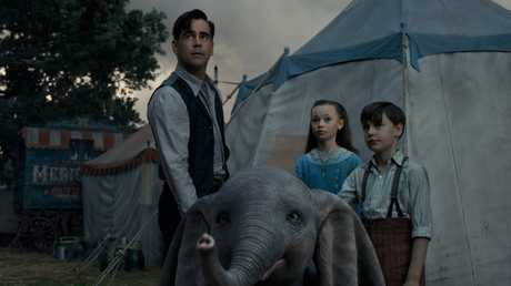 Colin Farrell, Nico Parker and Finley Hobbins in a scene from the movie Dumbo.