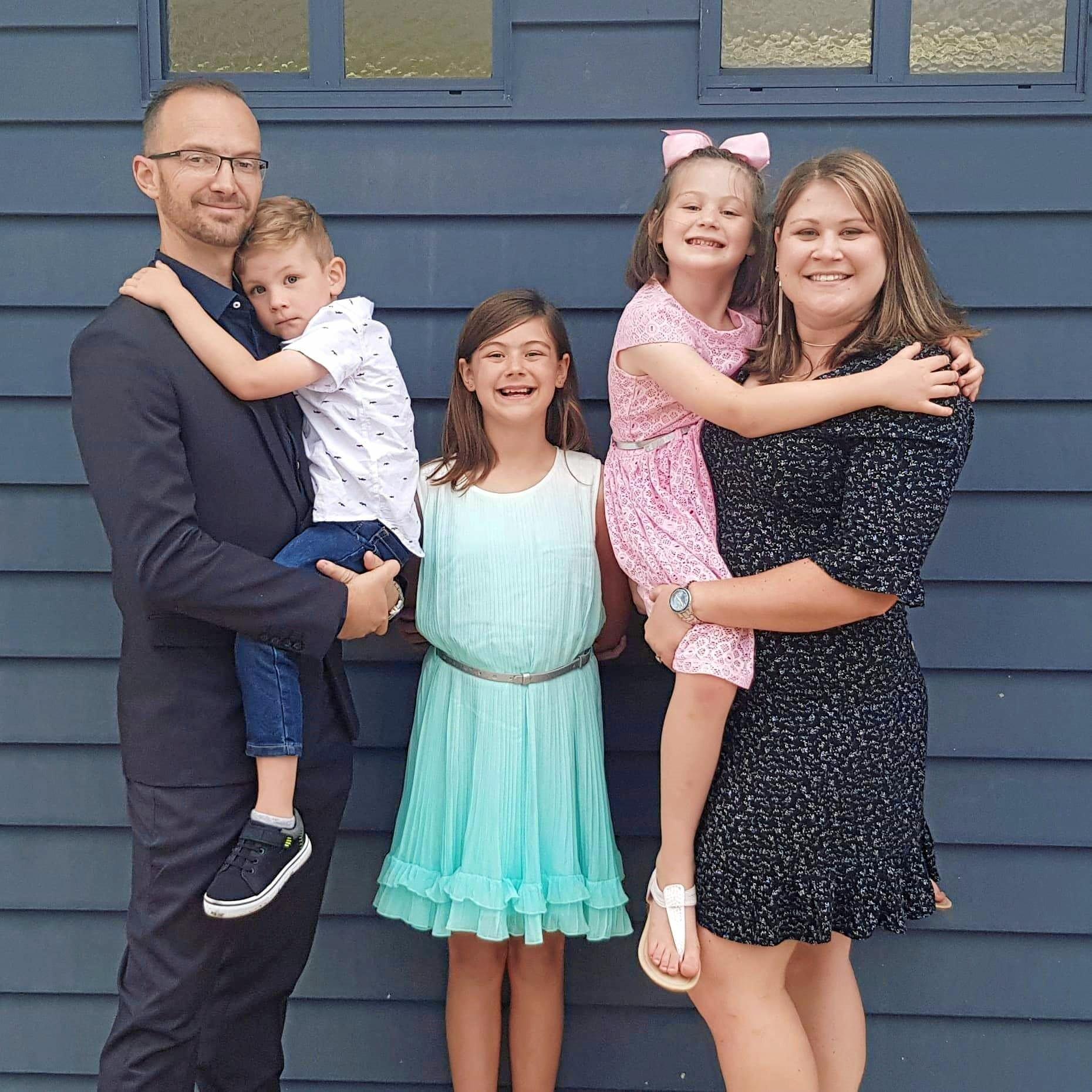 Tim, Ezekiel (4), Charlotte (11), Jazmin (7) and Rachel Dobson.