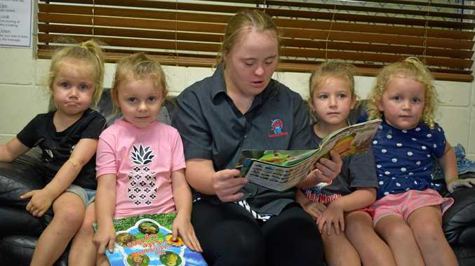 Elizabeth Frost reads to children Evie Curran, Ruby Lanesbury, Bronte Martin and Georgina Thornton at J.A.C's Learning World.