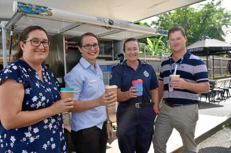 THANKS: Kaitlyn Hughes and Janelle Chapman from Cooloola Christian College show their appreciation for Gympie's emergency services workers, including Gympie police station's Sgt Odette Reid and communications officer Brett Lang.