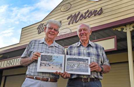 EXCITED: Hervey Bay Historian John Andersen and museum president Harold Collins show some of the rare postcards featured in the new book, Moments in Time.