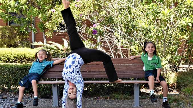 HIGH ACHIEVER: Amy Stephenson and daughters Isabelle and Ally at USC's Fraser Coast campus.