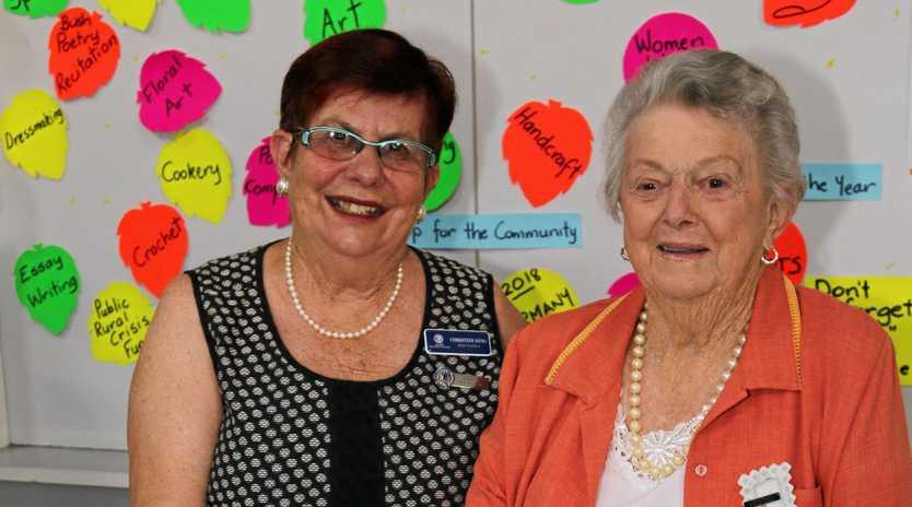 QCWA state president Christine King and Killarney QCWA president Daphe Pullen cut the cake to celebrate the 95th Anniversary of the Killarney QCWA.