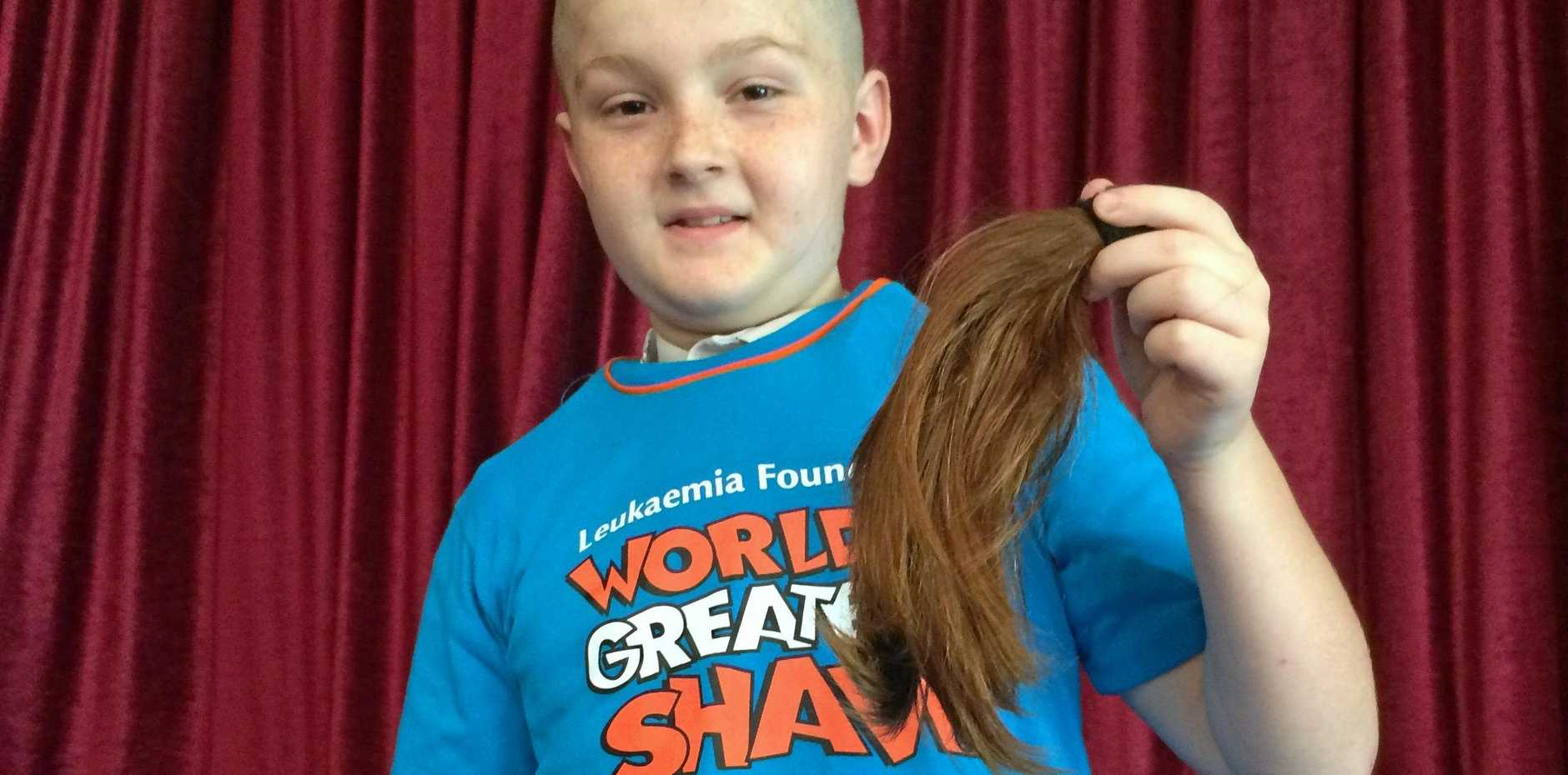 WORLD'S GREATEST SHAVE: Year 5 student Jordan Mealy holds up his shorn locks.