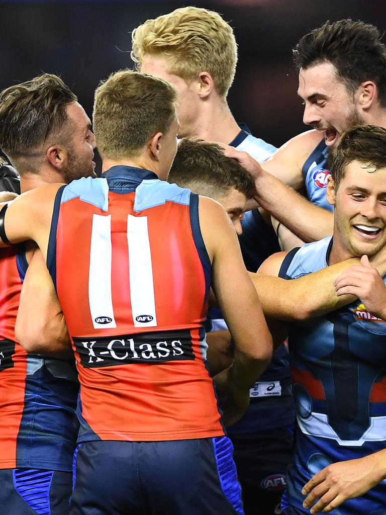 Taylor Duryea is mobbed by teammates after kicking his first goal for the Bulldogs. Picture: Quinn Rooney/Getty Images.