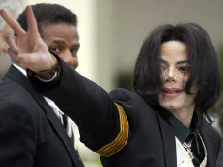Michael Jackson waves to his supporters as he arrives for his child molestation trial in 2005.