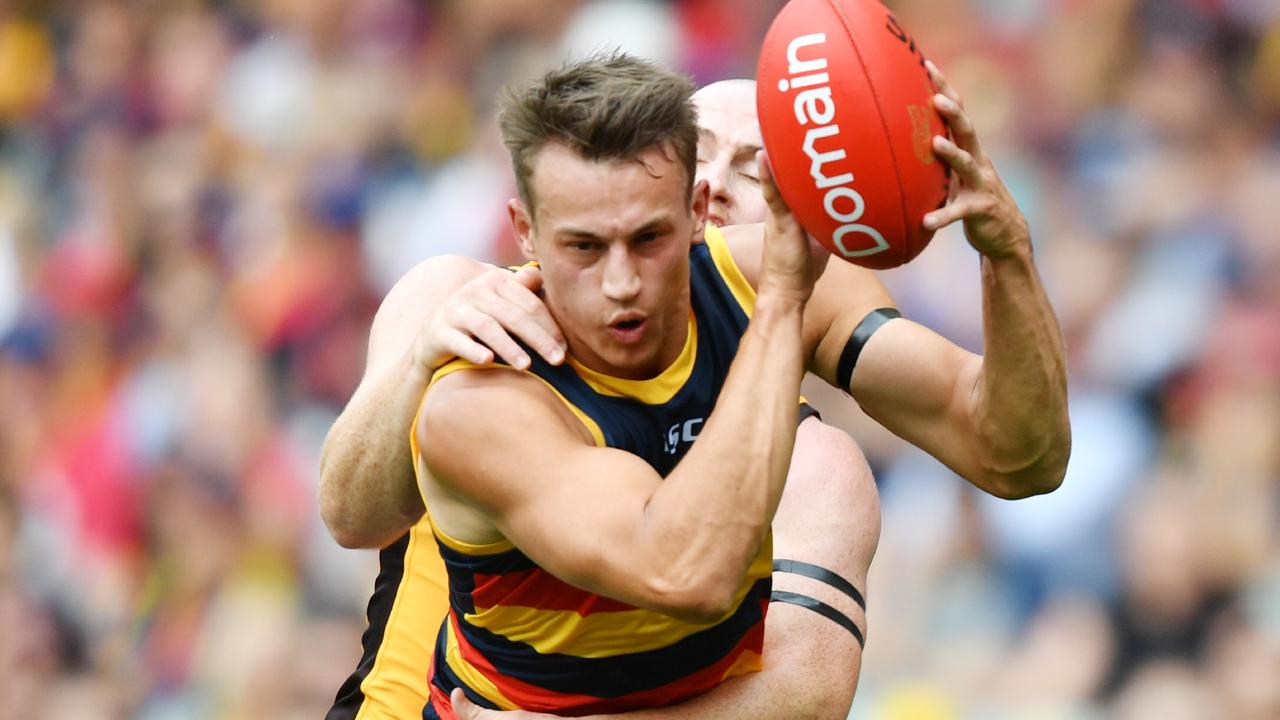 Adelaide's Tom Doedee marks in front of Jarryd Roughead on the weekend, shortly before tearing the anterior cruciate ligament in his knee. Picture: David Mariuz (AAP).