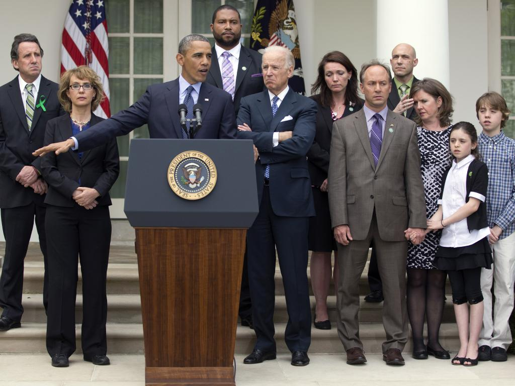 Richman (right, rear) with President Barack Obama during a 2013 news conference about the need to reduce gun violence at the White House, Wednesday, April 17, 2013. Pic: AP