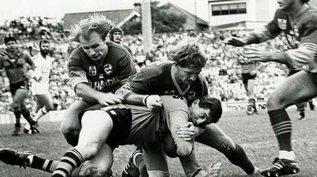 Peter Sterling (L) and Brett Kenny combined to tackle Balmain's Russel Gartner. But they were even more impressive in attack!