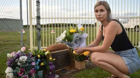 Nina Glesk lays flowers in memory of her father Juraj.