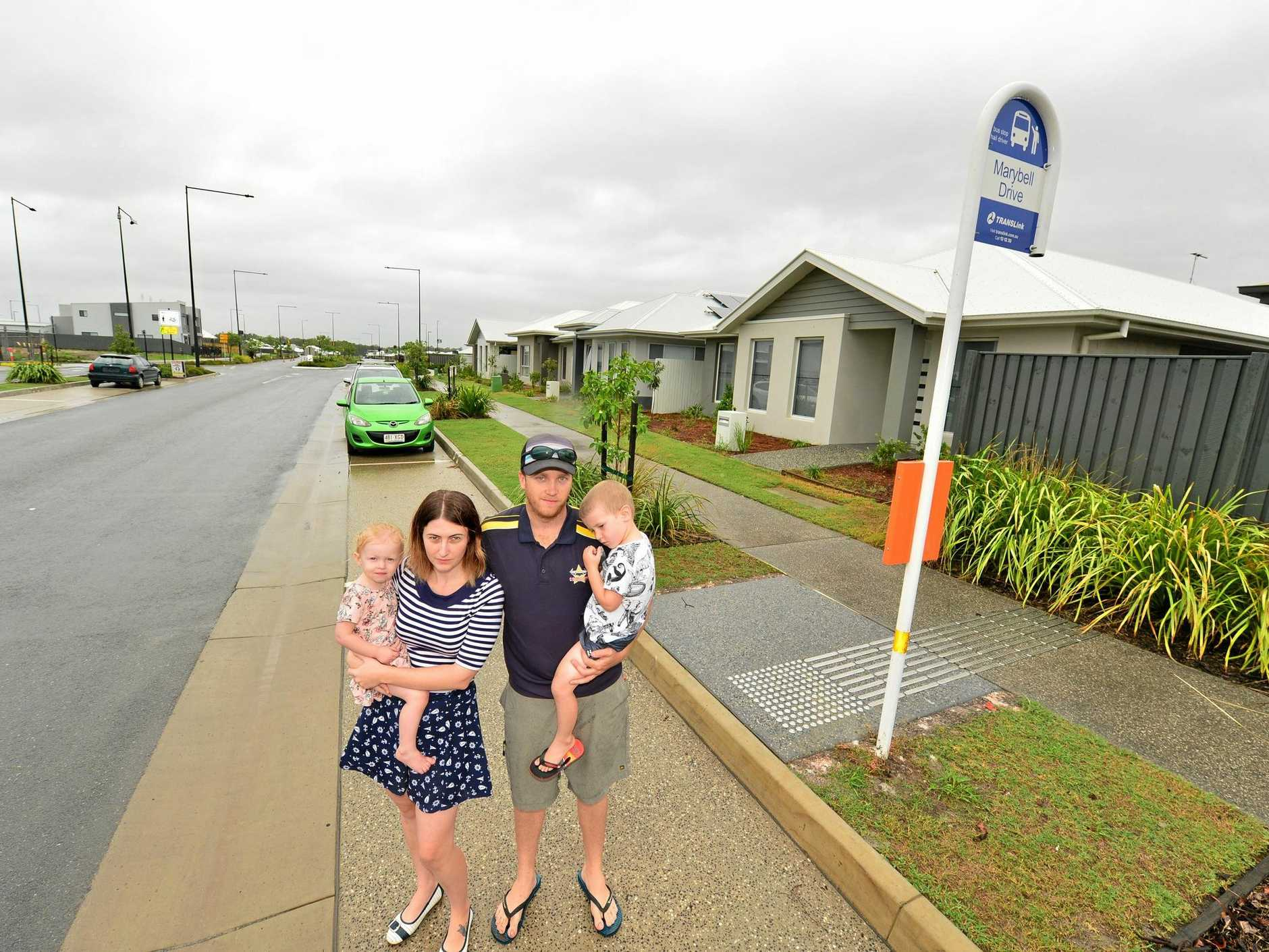 FRUSTRATED: Chris and Shae Simpson with their children Hamish and Bonnie are concerned that Translink are putting a bus stop right outside their home in Caloundra South.