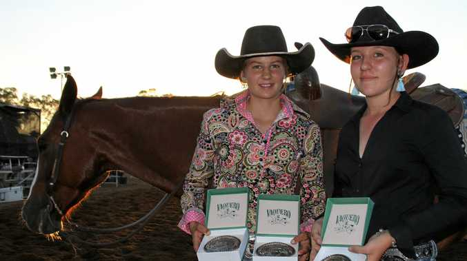 FIERCE COMPETITION: Lara Brownhall and Kate Smith at the SQCHA Chinchilla cutting competition.