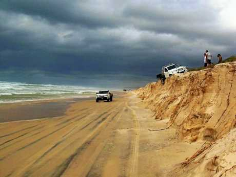 Beach goers were warned to stay off the dunes as high tides threatened to make Teewah Beach impassable when Cyclone Oma loomed off the coast.