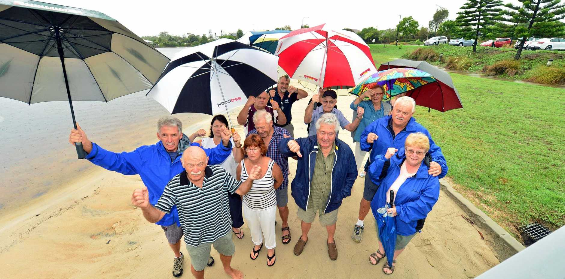 PROTEST: Residents at Pelican Waters protest about a proposed restaurant, bar and coffee shop they fear could affect their quality of life.