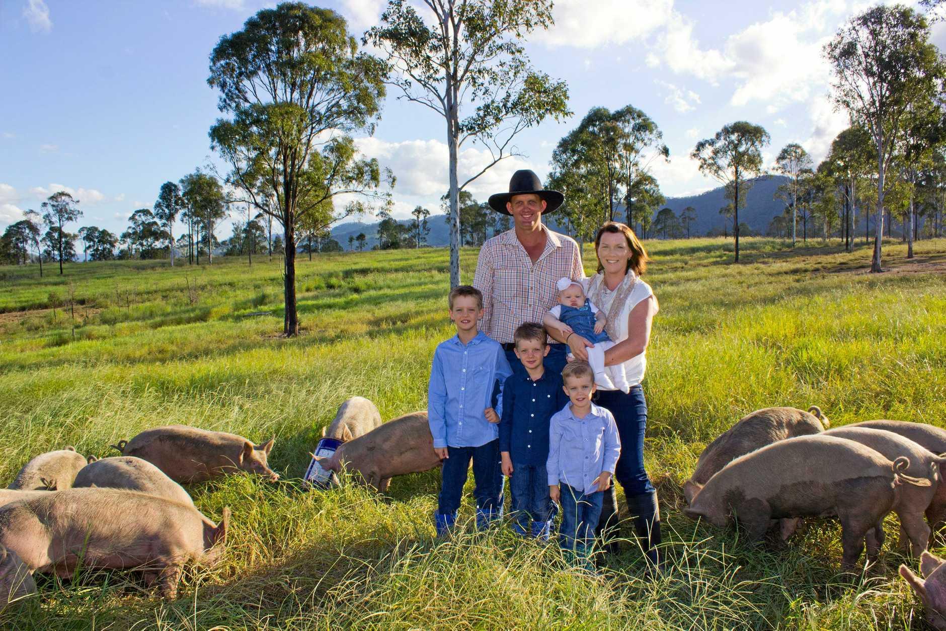 Brad and Melina Murnane (with their children) of Rhodavale Pork.