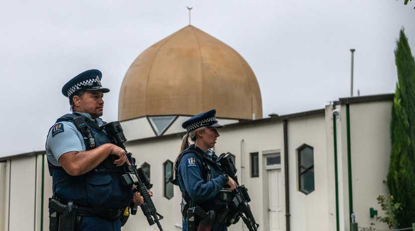 Armed police guard the Al-Noor Mosque in Christchurch after it was officially reopened following this month's terror attack. Picture: Carl Court/Getty Images