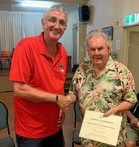 LIFE AWARD: Tony Eccles (right) receiving his Honary Life Membership from Sunshine Statesmen Barbershop Chorus President, Mal Woods.