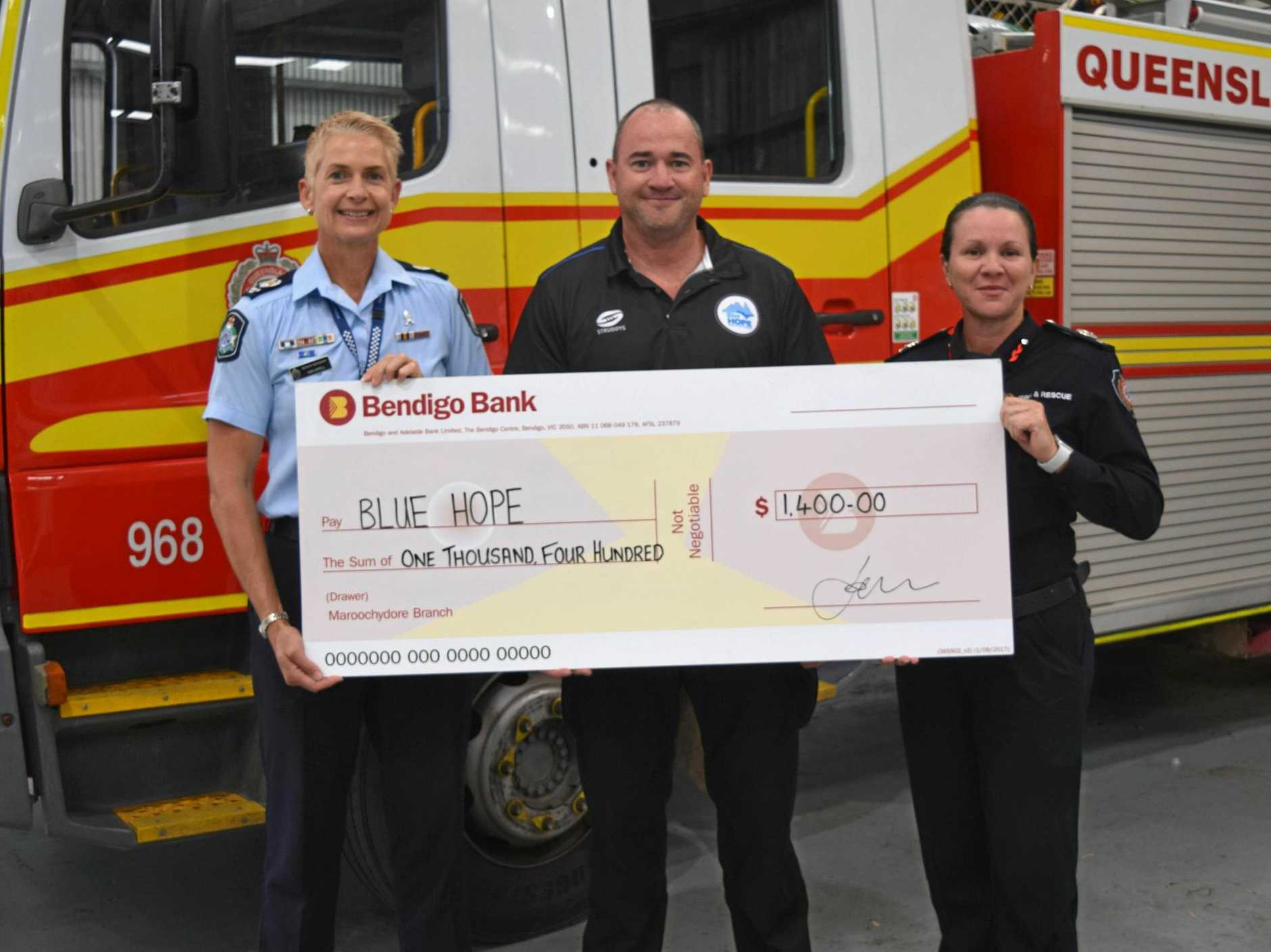 SIGNED, SEALED, DELIVERED: Senior Sergeant Kim Cavell and QFES Acting Assistant Commissioner Michelle Young present Andrew Ayres with a $1400 cheque.