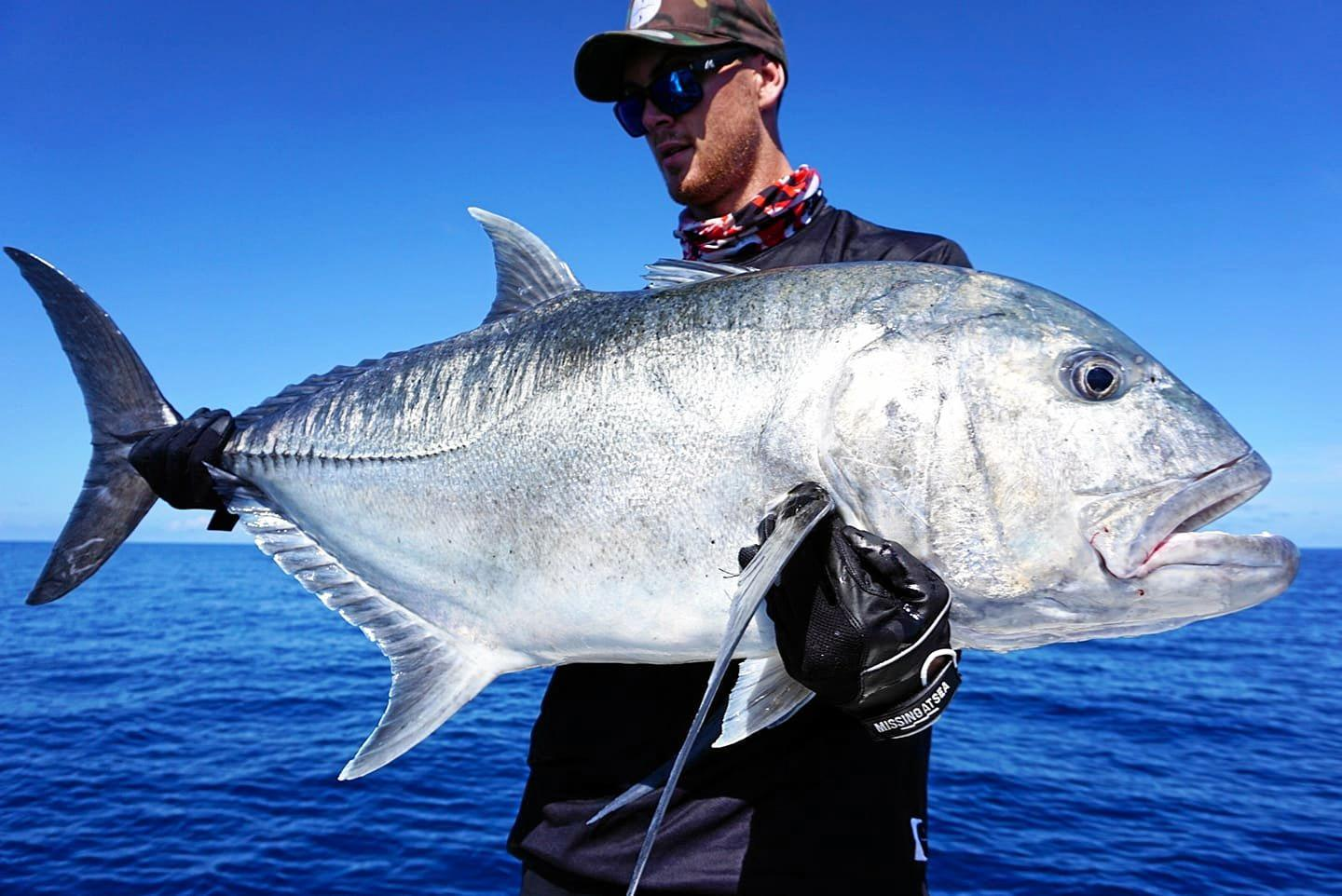 Jake Reilly with a giant trevally caught off Mackay.