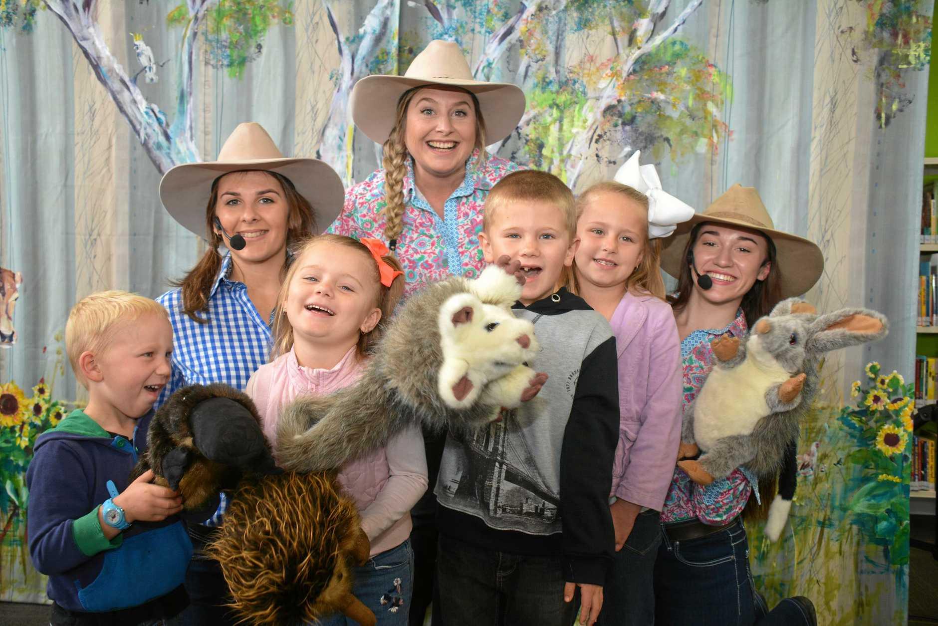Koala Rumba presenters Eden Smith, Cilla Pershouse and Georgia Spark with Kingaroy kids David Jones, Ciara Adams, Kahn Fleischfresser and Allyrah Adams after the Kingaroy library concert on July 4 last year.