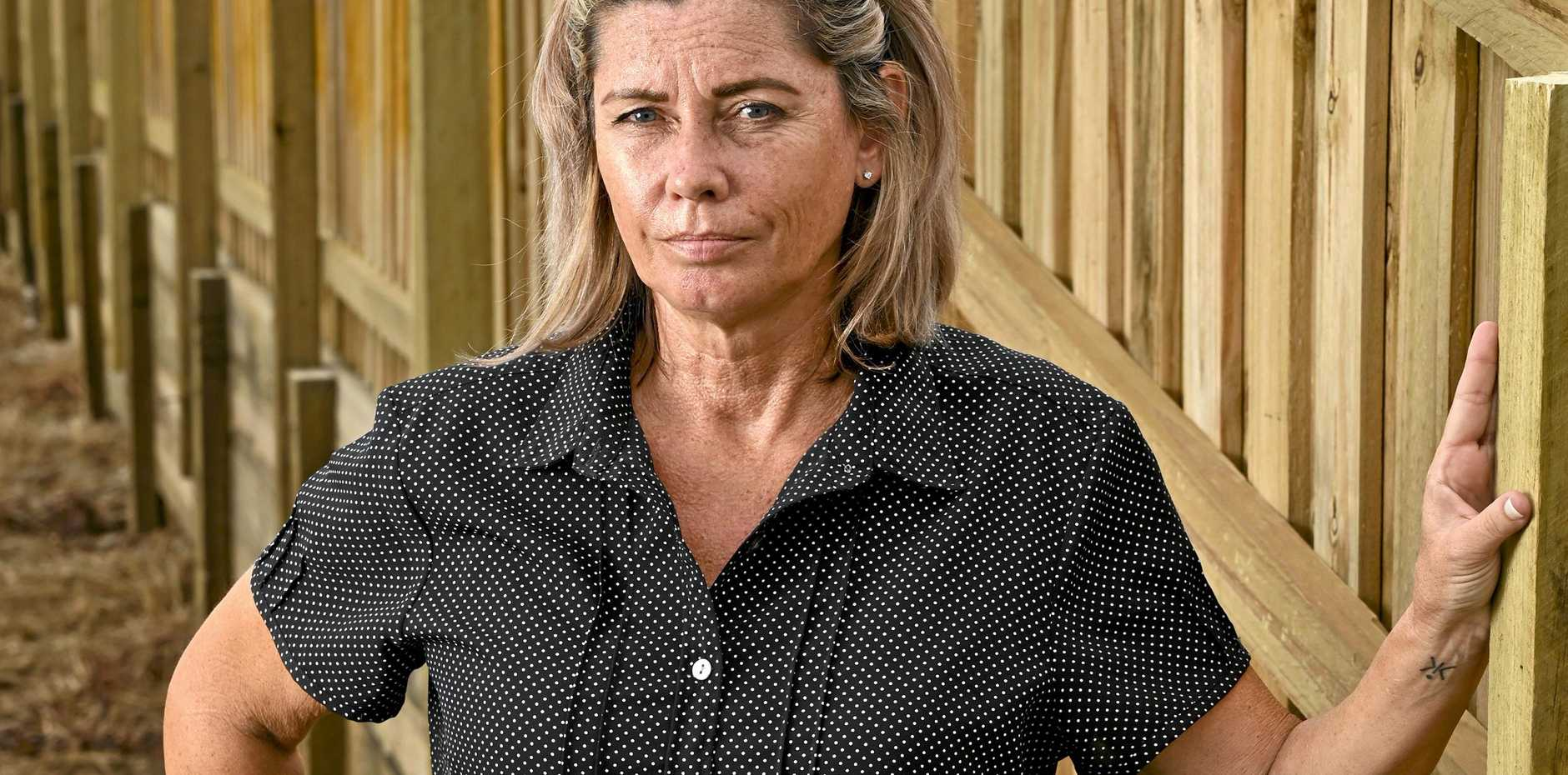 DIVIDED: Sue Bishop is unhappy after not being compensated for building a fence bordering her home at Deebing Heights.