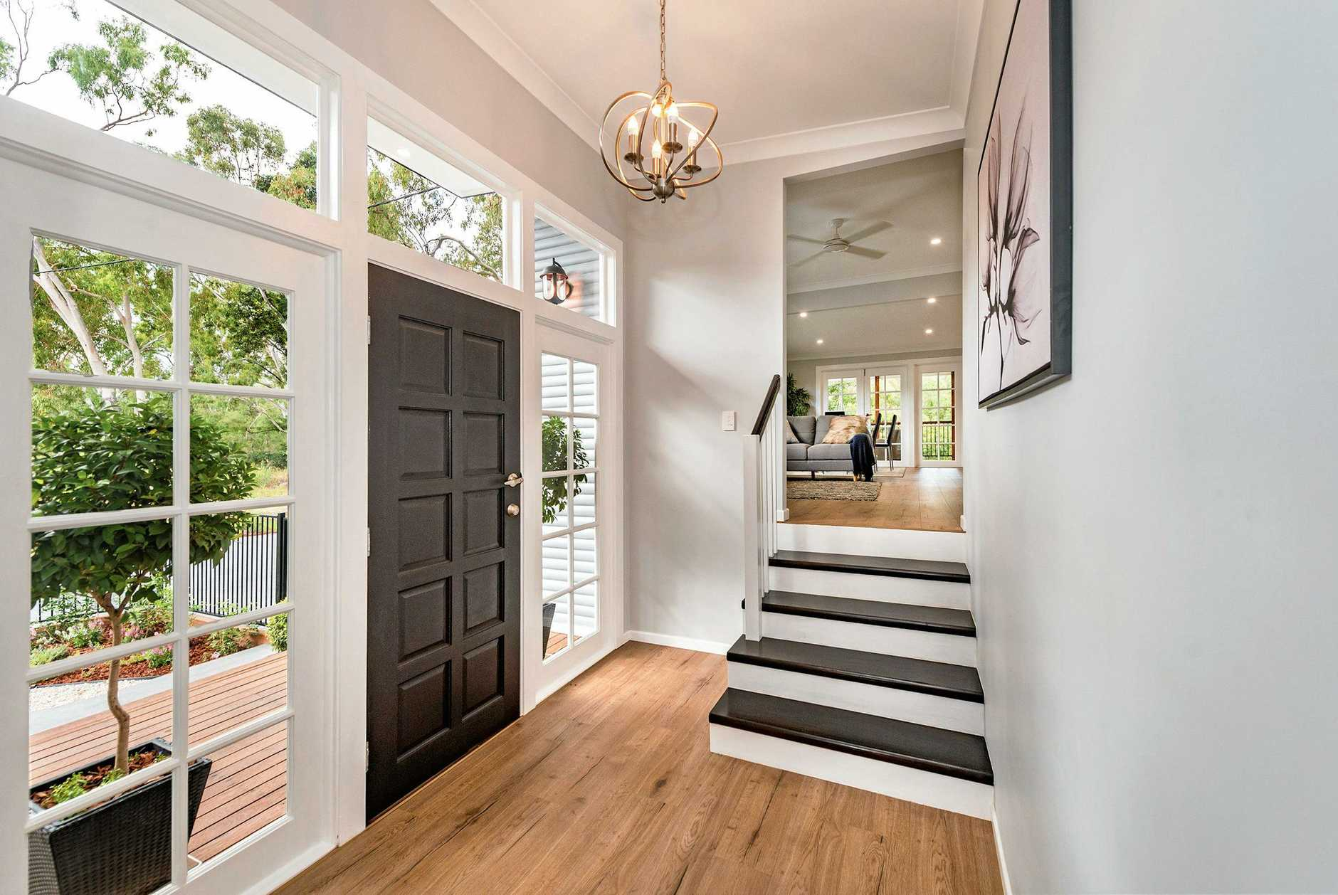The stunning entry breathes life into the recently renovated home, bathing the space in natural light.