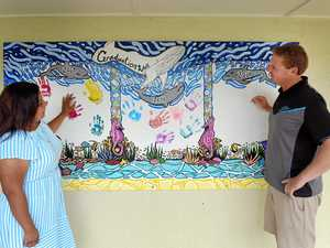 Mural restored after graffiti wiped away at special school