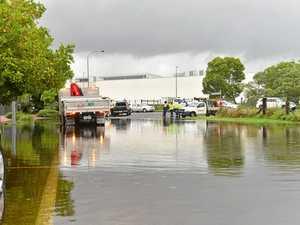 Water floods busy Maroochydore street