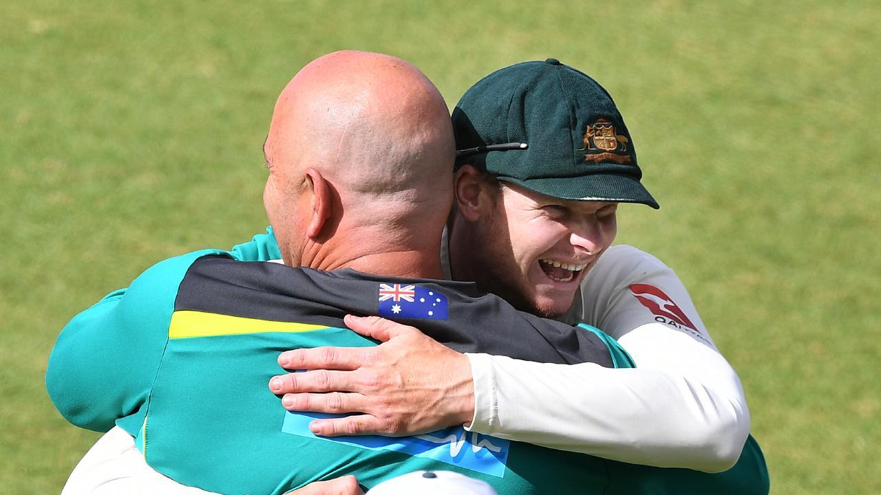 Steve Smith (right) hugs coach Darren Lehmann