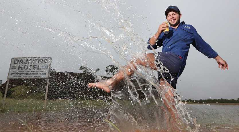 Station hand Dylan Brown celebrating the rains near Djarra in outback Queensland. Picture: Peter Wallis