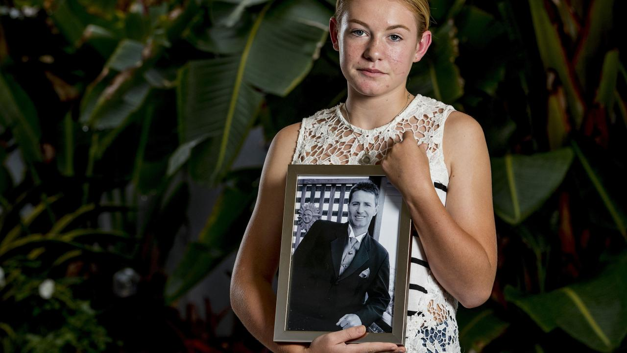On 12 January 2018, Cayla Sweeney (12 at the time) rescued her father after an incident on a canal on the Gold Coast, Queensland. Cayla Sweeney holding a photo of her father Neil Sweeney. Picture: Jerad Williams