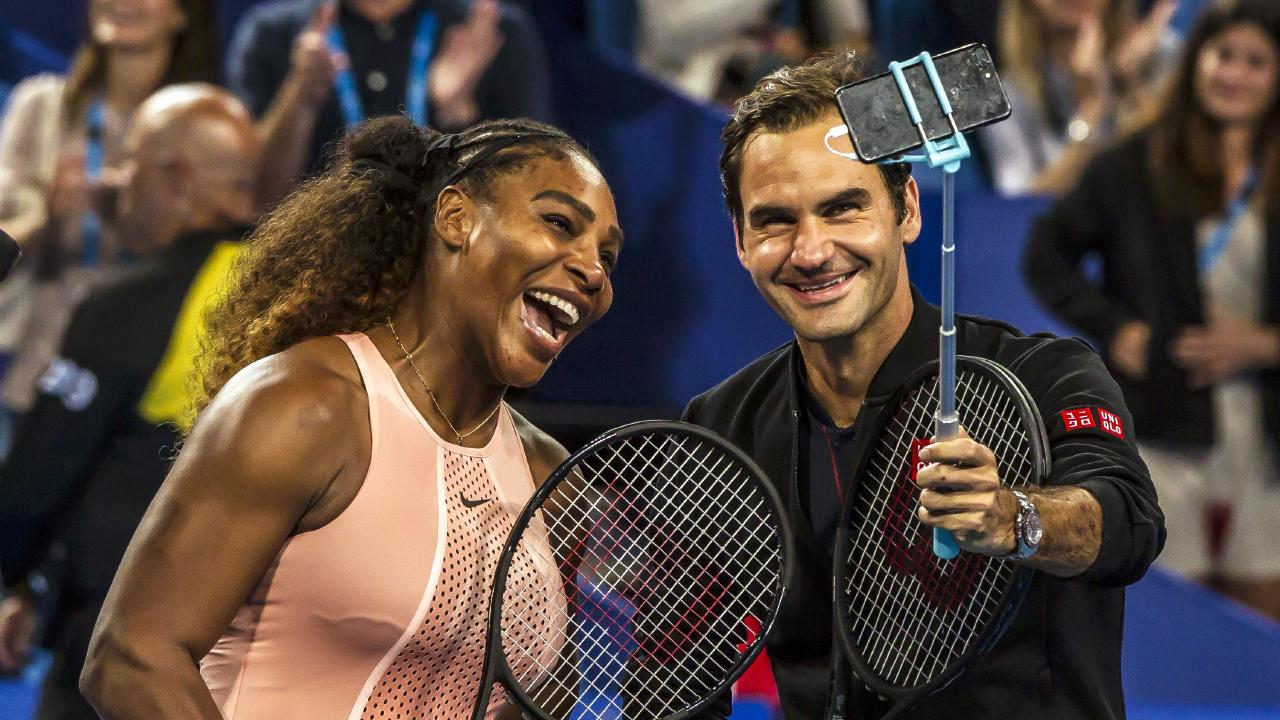 Serena Williams and Roger Federer take a selfie following their mixed doubles match of the 2019 Hopman Cup. Picture: Tony Ashby/AFP