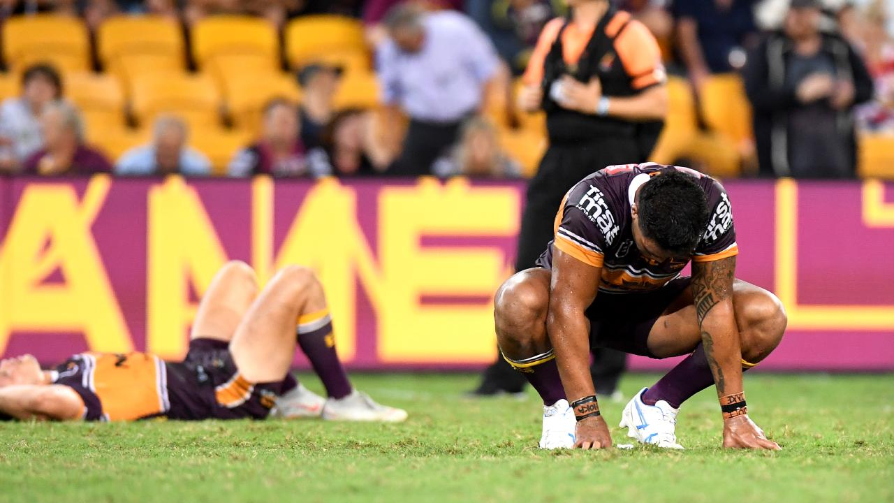 Broncos players slump to the turf following their loss to the Dragons. (Photo by Bradley Kanaris/Getty Images)