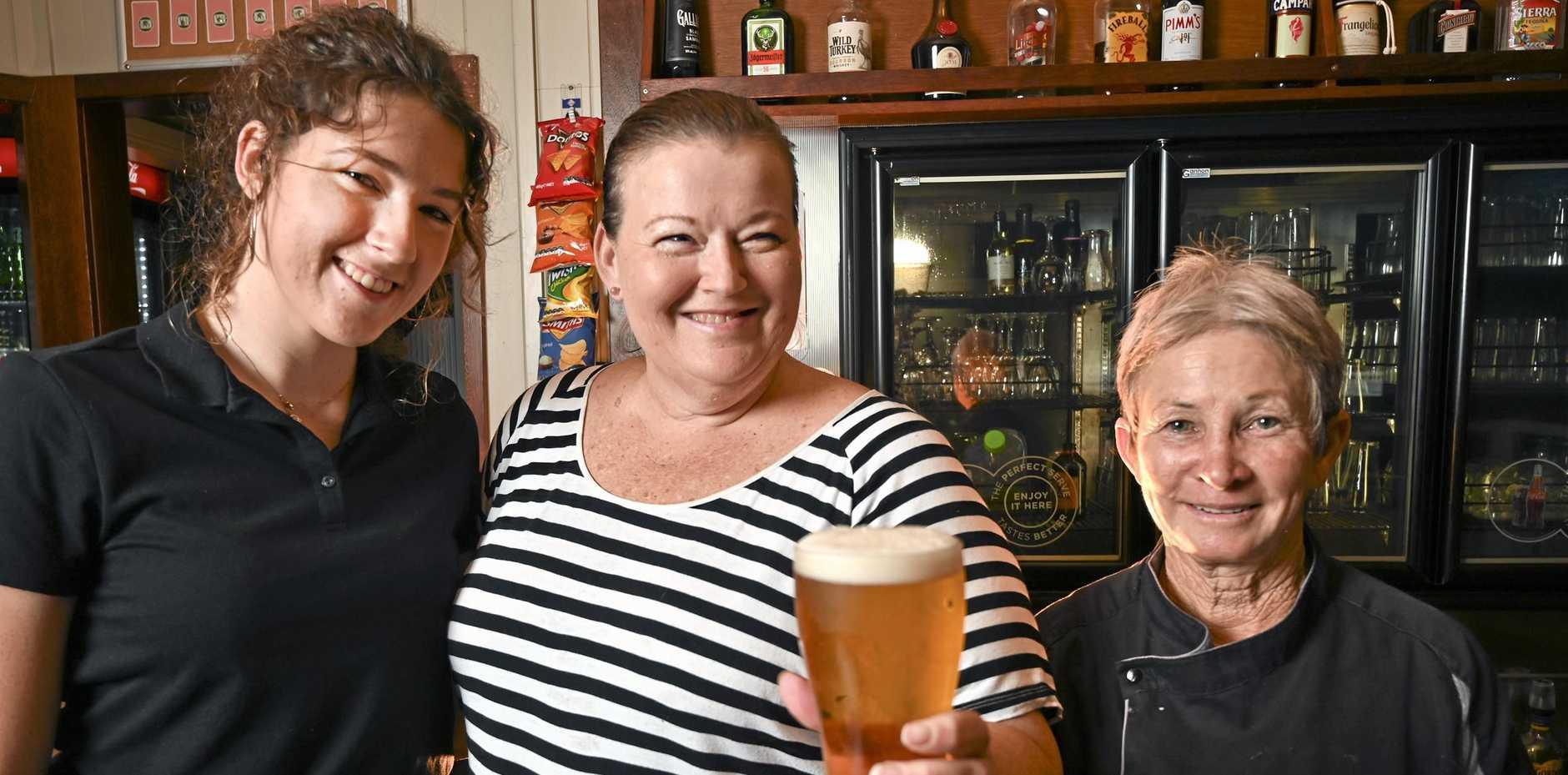 CHEERS: Waitress Lainey Treadaway, owner Kelli Baartz and chef Vera Turgean at the Royal Hotel Kalbar.