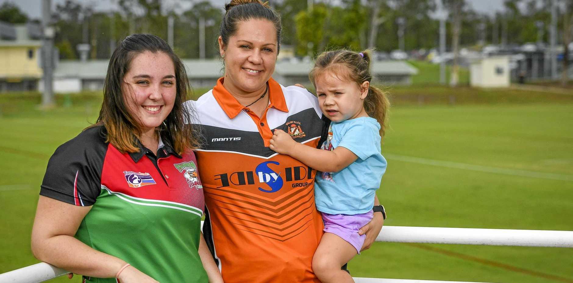 WOMEN POWER: Gladstone Wallabys' Sarah Stewart with daughter Taylor Butler, 2 and Tannum Seagals' Jamie Gehrmann