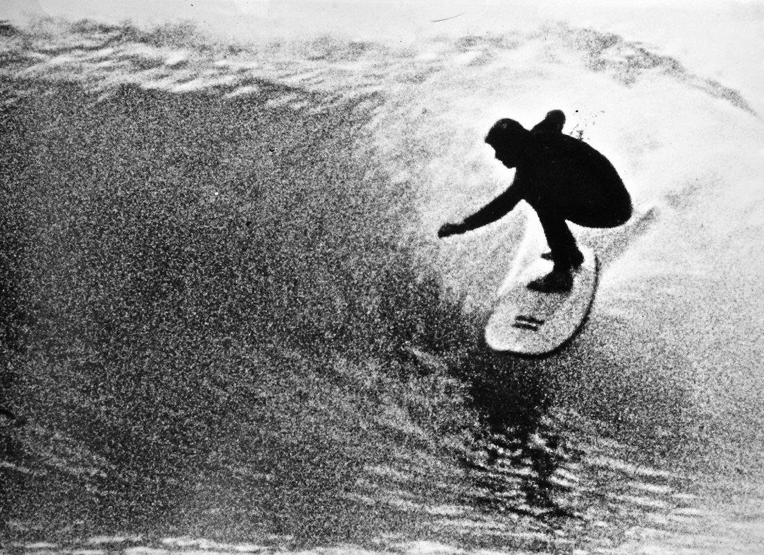 A classic surfing image of David 'Baddy' Treloar surfing the inside section at Angourie.