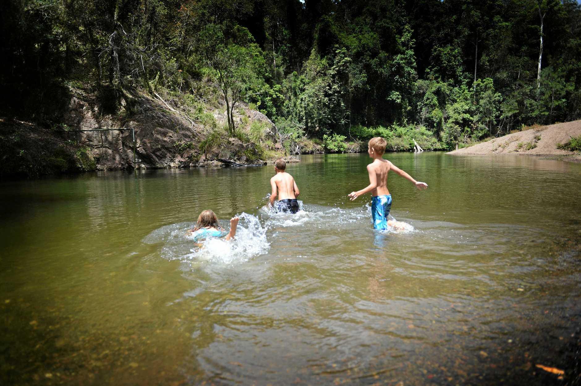 Children enjoy the water hole at Cedar Grove
