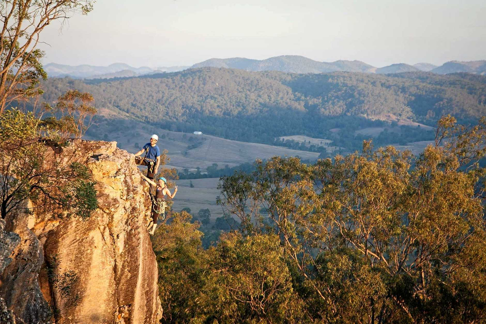 Bruno Gohier and Olga Kuznetsova stand on the edge at the top of their climb at Brooyar State Forest, near Gympie.