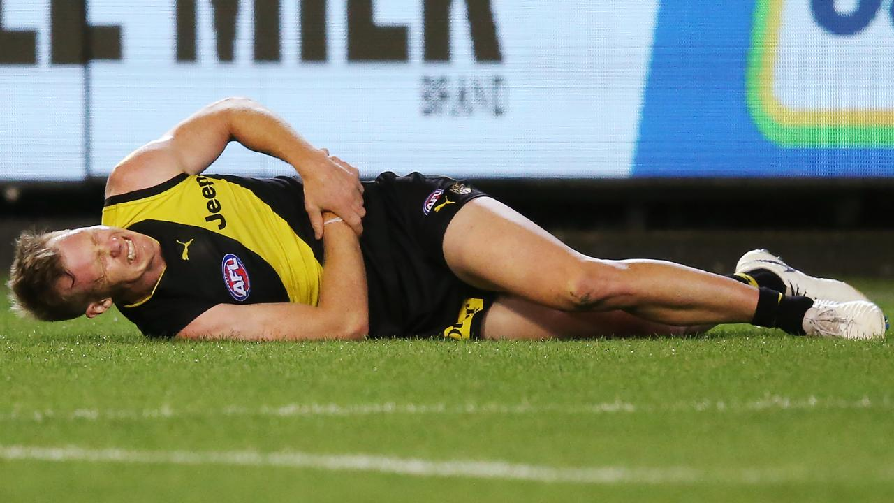 Jack Riewoldt reacts after hurting his wrist. Picture: Getty Images