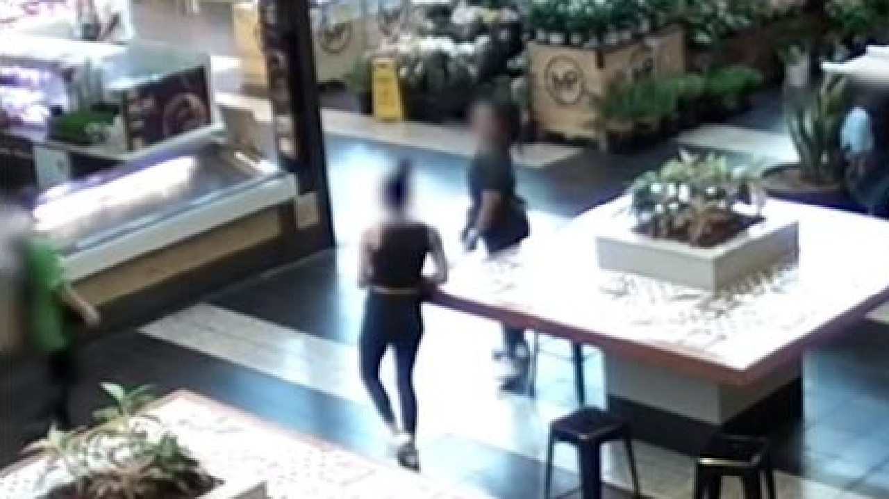The teen girls loitered in the Melbourne shopping centre waiting for the chicken shop worker. Source: Nine