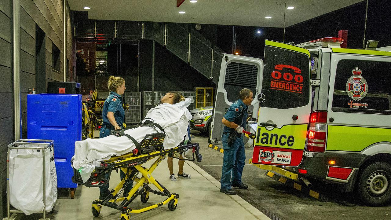 QAS handing patient to the Gold Coast University Hospital (GCUH).  Picture: Jerad Williams
