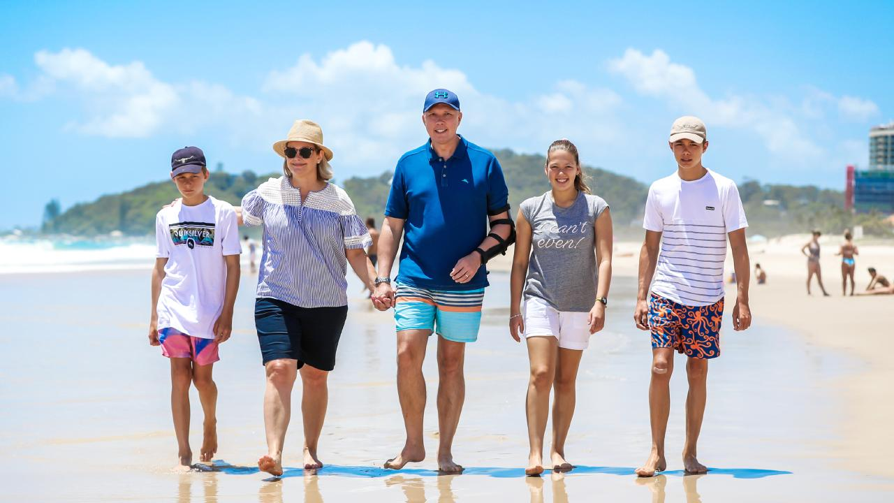 Peter Dutton poses for photos with his family - wife Kirilly with their two sons Harry, 14 (right) and Tom, 13 (left) and daughter Rebecca - during a holiday on the Gold Coast. Picture: Nigel Hallett