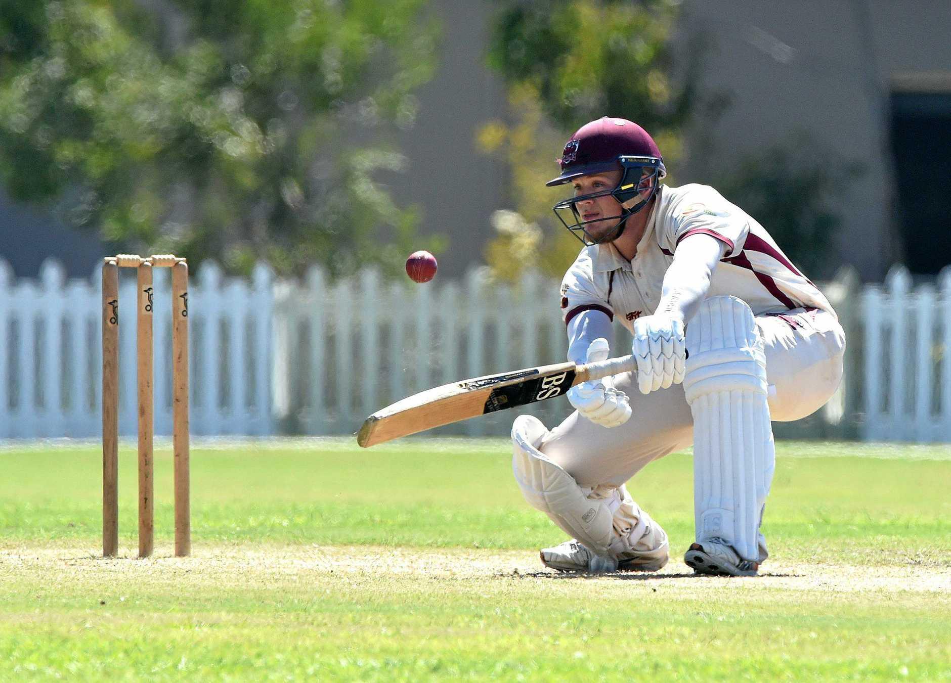 Caboolture batsman Jayden Coffin keeps an eye on a low ball.
