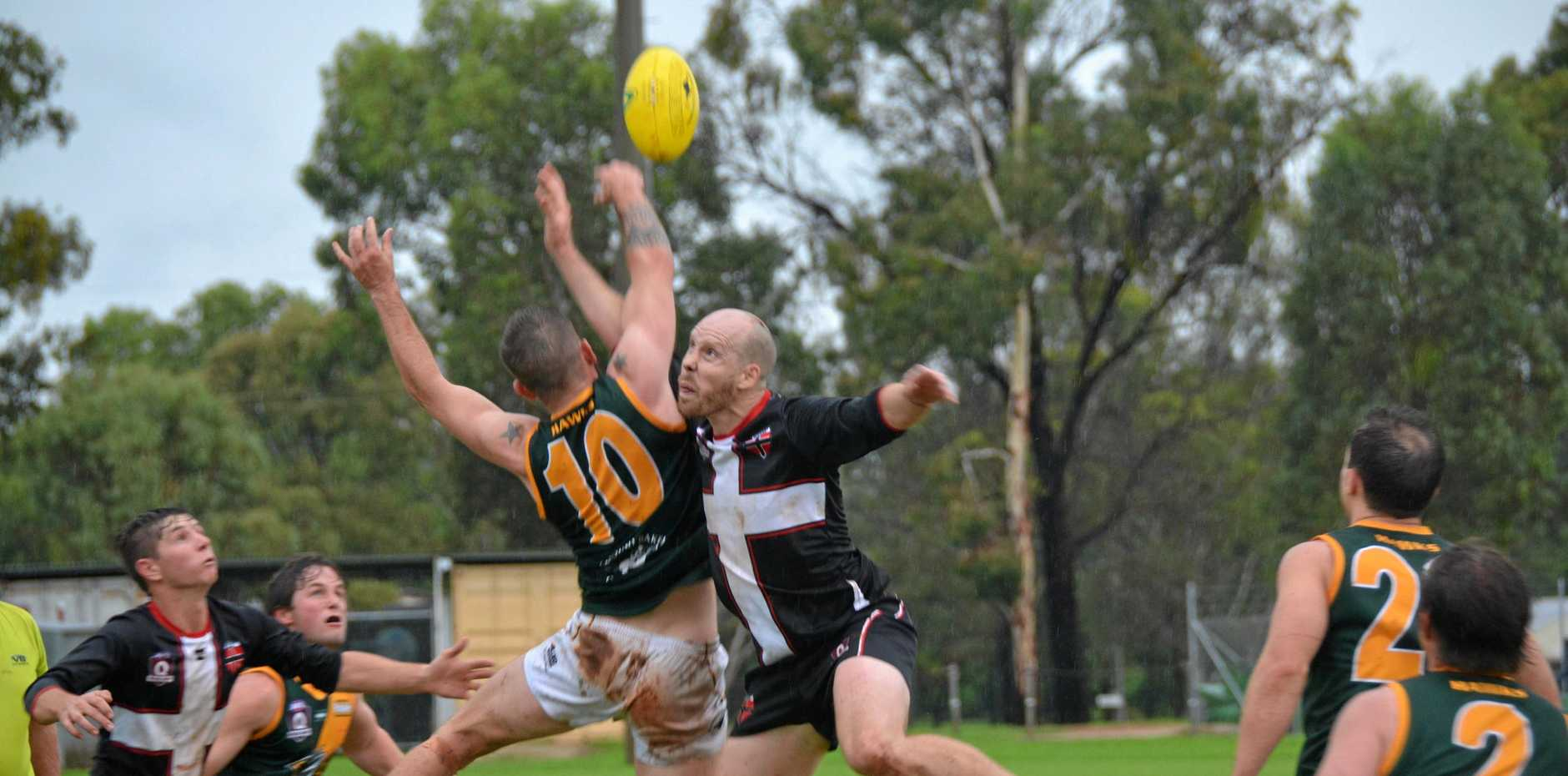 SEASON OPENER: The South Burnett Saints against the Goondiwindi Hawks in round one of the AFL Darling Down 2019 season.