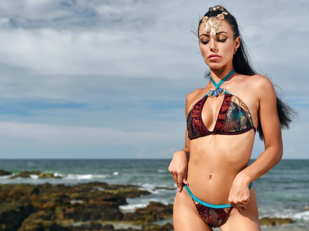 Swimsuit model and mental health advocate Melanie Bragg modelling the $35,000 OPAL bikini by Veve Swimwear designer Vanessa Bryce teamed with local jewellery designer Vanessa Nock.