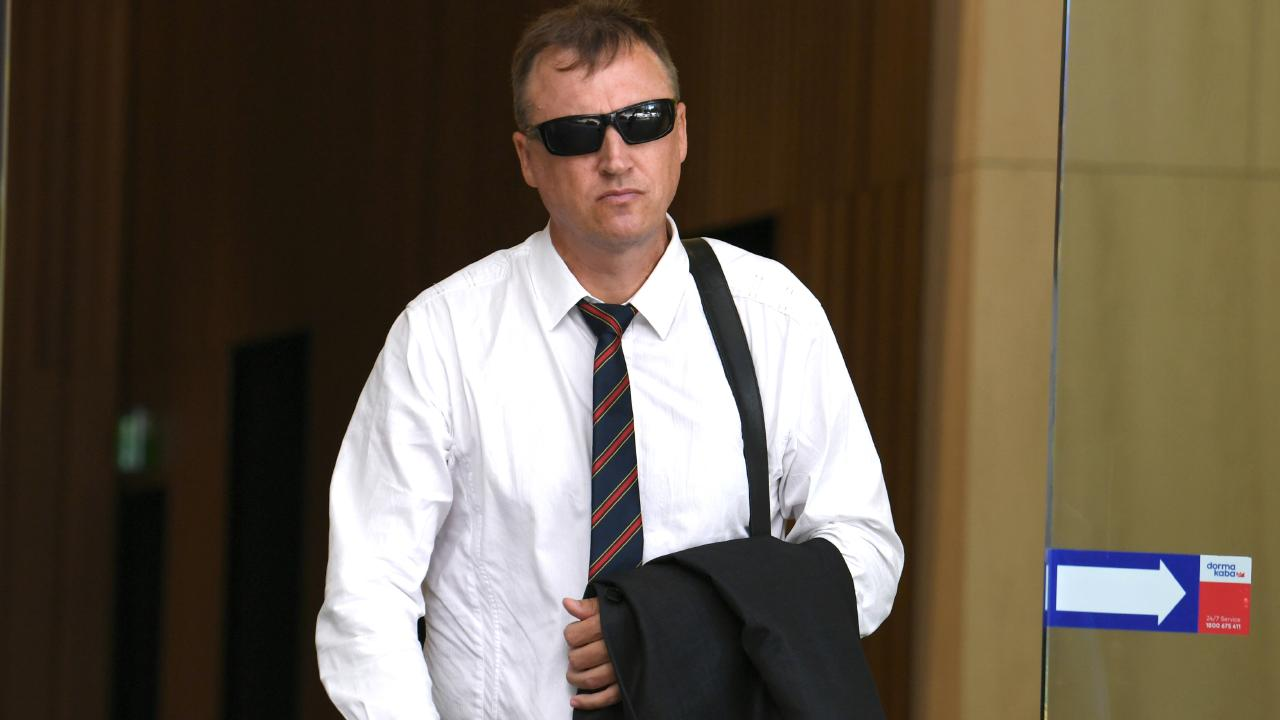 Senior Constable James Treanor leaves the Queensland Industrial Relations Commission in Brisbane. Picture: AAP image/John Gass