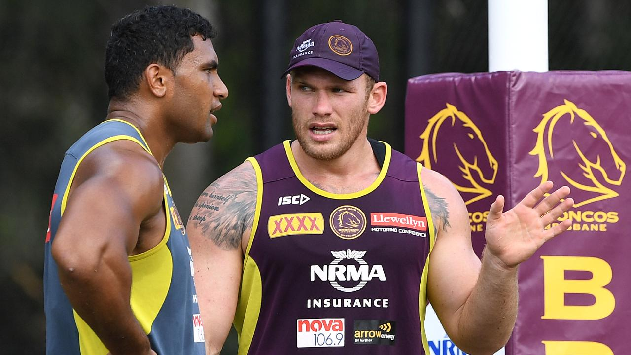 Tevita Pangai Junior (left) and Matt Lodge are seen during the Brisbane Broncos training session at Red Hill in Brisbane, Tuesday, March 20, 2018. The Broncos will play the Wests Tigers in Sydney on Friday. (AAP Image/Dave Hunt) NO ARCHIVING